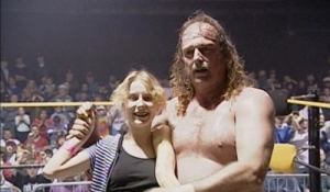 Jake 'The Snake' Roberts with a fan