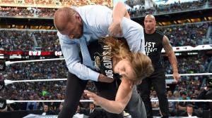 Rhonda Rousey with a hip throw on Triple H