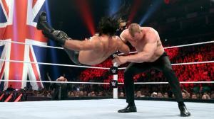 Kane chokeslams Rollins