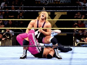 Owen Hart with the Sharpshooter on Bret Hart