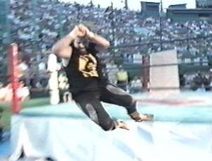 Cactus Jack delivers his flying elbow