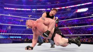 Ambrose canes Lesnar