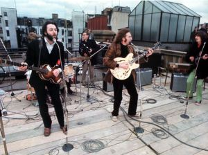 Paul McCartney, John Lennon and George Harrison on the Apple Corps roof