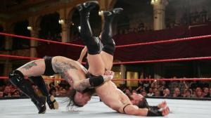 Tommy End with a bridging German Suplex on Adrian Neville