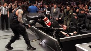 Roman sends Owens through the table