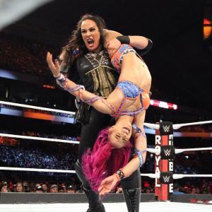 Nia Jax locks a strech muffler on Sasha Banks
