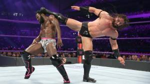 Neville hits a superkick on Swann