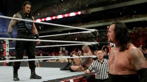 Reigns stares down The Undertaker
