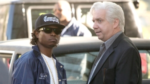 Eazy-E (Mitchell) and Jerry Heller (Giamatti)