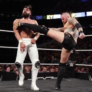 Andrade Almas takes a kick from Aleister Black