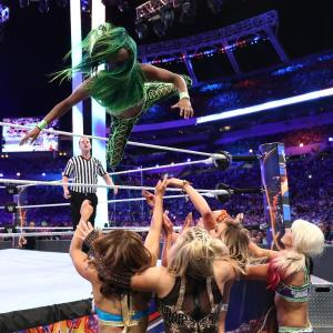 Naomi flies over the top rope