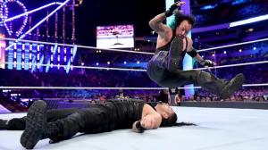 The Undertaker legdrops Roman Reigns