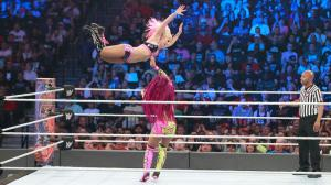 Alexa Bliss dives at Sasha Banks