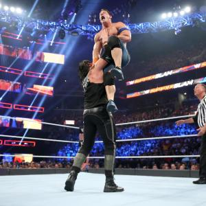 Baron Corbin chokeslams John Cena