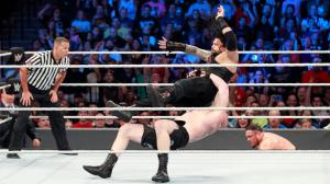 Brock Lesnar suplexes Roman Reigns