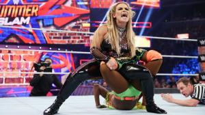 Natalya applies the Sharpshooter to Naomi