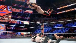 Seth Rollins with a frog splash on Sheamus