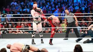 Rollins hits a superkick on Sheamus