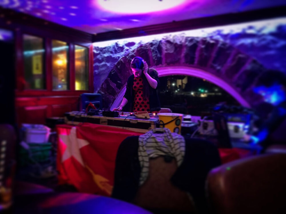 Jade DJing at the Vale Earth Fair DIY Disco night