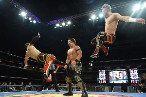 Eagles and Ospreay deliver a tandem kick to Ishimori