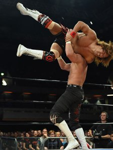 Naito spins into a tornado DDT on Switchblade